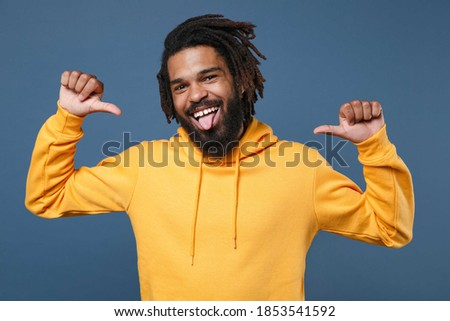 Image of funny african american guy in hoodie sticking out his t Stock photo © deandrobot