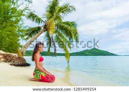Tahiti luxury exotic travel vacation girl with polynesian flower walking on beach landscape with pal Stock photo © Maridav