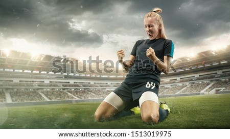 Young female football player holding soccer ball while training in isolation Stock photo © pressmaster