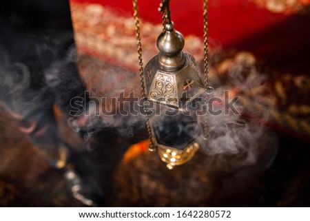 A priest's censer hanging in the Orthodox Church. Copper incense with burning coal inside. Stock photo © Len44ik