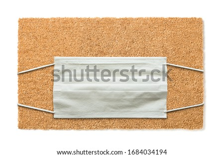 Blank Welcome Mat With Medical Face Mask Amidst The Coronavirus  Stock photo © feverpitch