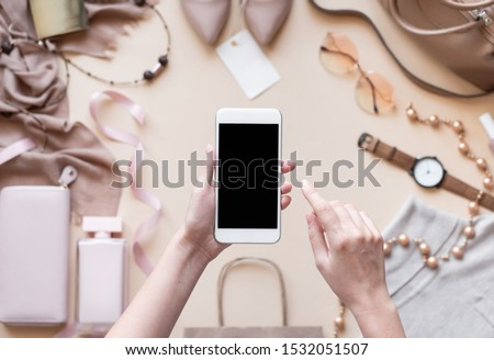 Hand holds the smartphone with present in the online store. Flat vector modern phone mock-up illustr Stock photo © karetniy