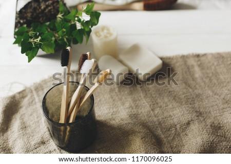 Zero waste concept. Bamboo toothbrush on wooden background. Plastic free essentials, teeth care. Sus Stock photo © galitskaya