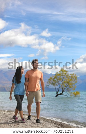 New Zealand tourists couple visiting Wanaka Lone Tree walking by lake. Happy young people traveling  Stock photo © Maridav
