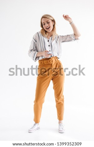 Photo of nice happy woman earpods and smartphone while sitting Stock photo © deandrobot