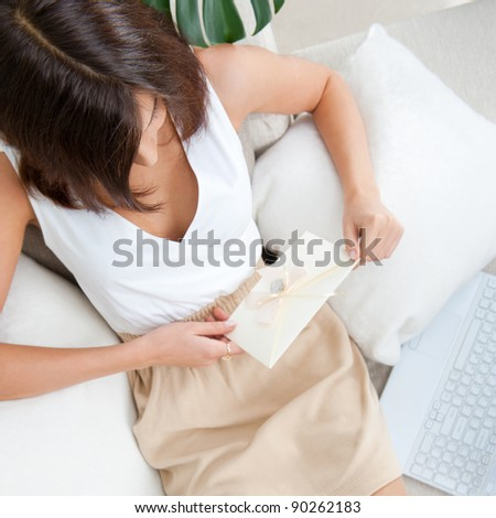 View from above of happy girl lying on sofa holding letter with  Stock photo © HASLOO
