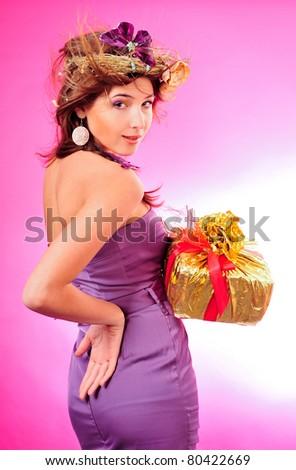 Aranyos mosolyog lány tart arany doboz Stock fotó © HASLOO
