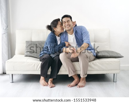 portrait of a happy family of mother and her son sitting togethe stock photo © hasloo