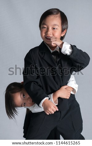 Man and woman in smart suit and little boy dressed as a businessman Stock photo © photography33