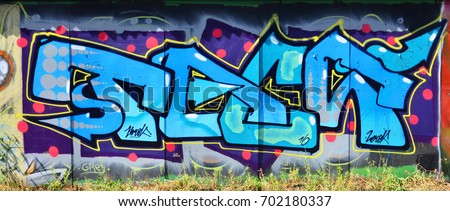 Graffitti spray paint - spraypaint vandalism grunge city urban y stock photo © jeremywhat