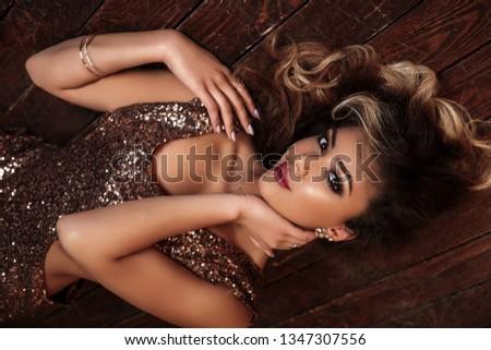 fashionable photo of beautiful woman with jewelry on light bacgr stock photo © pawelsierakowski