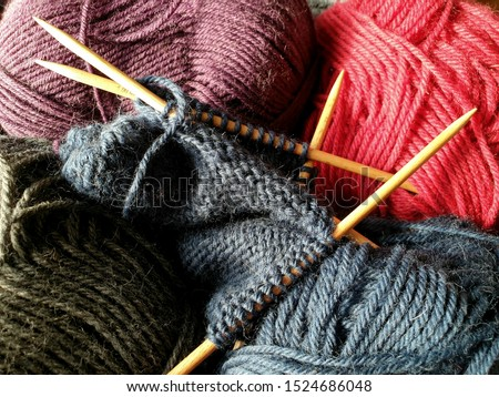 Balls of wool in variety of colours with wooden knitting needles stock photo © TheFull360