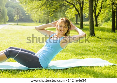 Fitness instructor doing situp exercise and turning to camera Stock photo © get4net