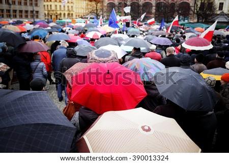wroclaw poland a person with umbrella on the rainy market square stock photo © photocreo