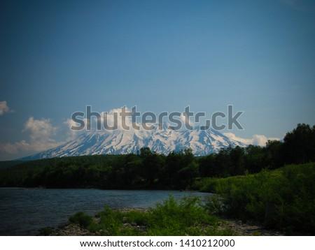 View of Nalychevo Nature Park and Zhupanovsky volcano at sunrise Stock photo © amok