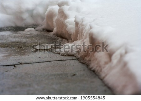 Melting snow slush on a road close up natural abstract background. Stock photo © latent