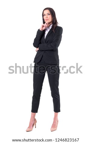 Full-length portrait of a young thoughtful woman in formal dress on gray background Stock photo © deandrobot