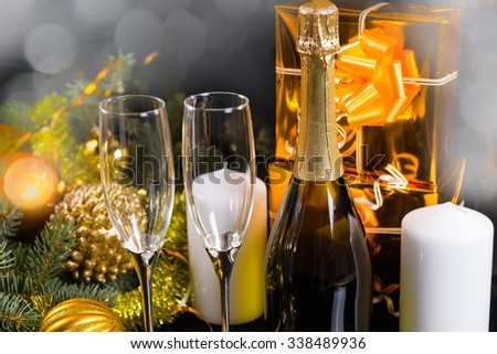 Stock photo: two glasses with champagne old pocket watch cork and confetti in front of a champagne bottle
