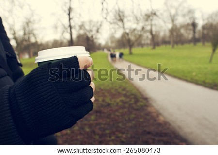 man with a hot drink in a paper cup in Hyde Park in London, Unit Stock photo © nito