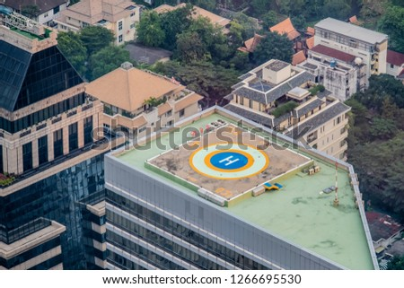 helipad for helicopter on roof top building for people transport Stock photo © FrameAngel