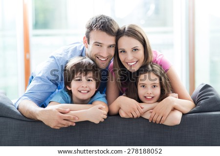 Smiling family with two children. father, mother, son and daughter is walking in early fall park. Stock photo © Paha_L