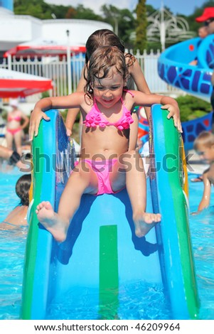 pretty little girl goes down on hill in aquapark of an entertain Stock photo © Paha_L
