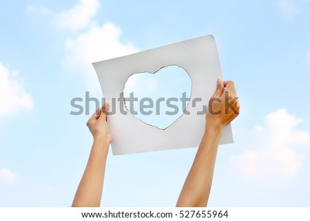 the sheet of paper with the cut hole against the black background stock photo © Paha_L