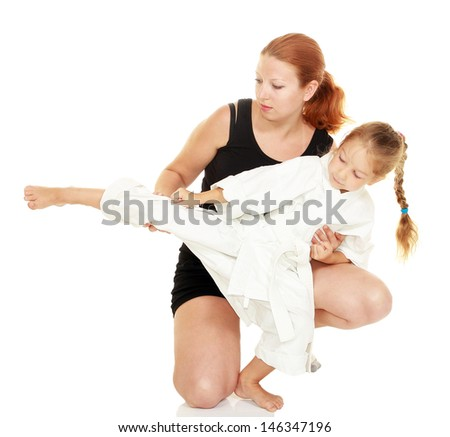 Mom teaches daughter dressed in a kimono karate kick insulated Stock photo © Andreyfire