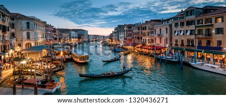 gondolas and tourist boats traffic on the grand canal in venice italy stock photo © photocreo