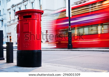 Traditional red mail letter box and red bus in motion in London, the UK. Stock photo © photocreo