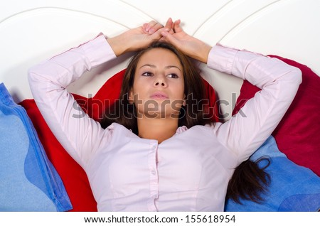 Photo of pretty and voluptuous woman lying on the bed Stock photo © majdansky