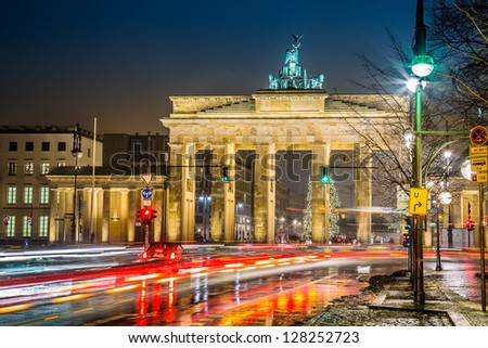 Road signs or street signs at Brandenburg gate in Berlin, German Stock photo © vladacanon