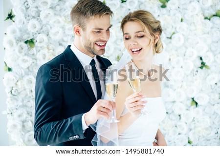 Kettő vonzó nők ünnepel esküvő pezsgő Stock fotó © deandrobot
