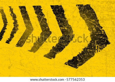 grunge distressed yellow road marking arrows on dark metal backg stock photo © shawnhempel