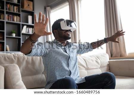 Satisfied businessman with VR goggles headset enjoying virtual r Stock photo © stevanovicigor