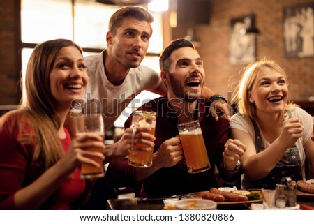 group of friends having beer while watching match at bar restaurant stock photo © wavebreak_media