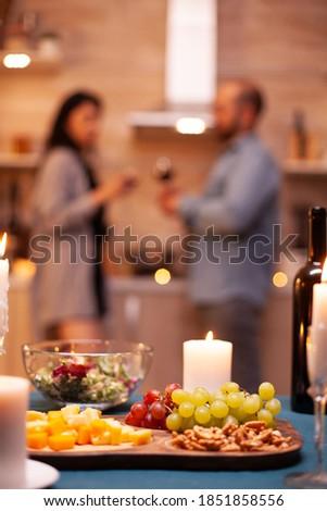 Close-up of couple toasting glasses of wine while having meal Stock photo © wavebreak_media