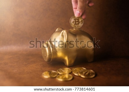 Bitcoin cryptocurrency miner inserting BTC into piggy coin bank Stock photo © stevanovicigor
