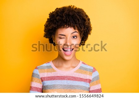 Close-up photo of young charming brunette woman blinks one eye a Stock photo © deandrobot