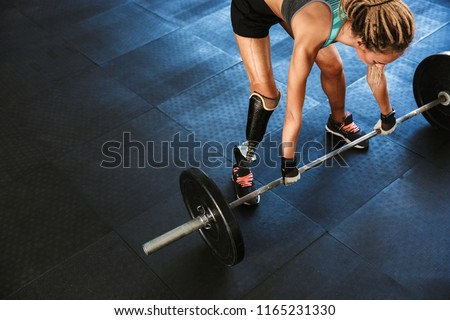 Portrait of gymnastic disabled woman wearing prosthesis in track Stock photo © deandrobot