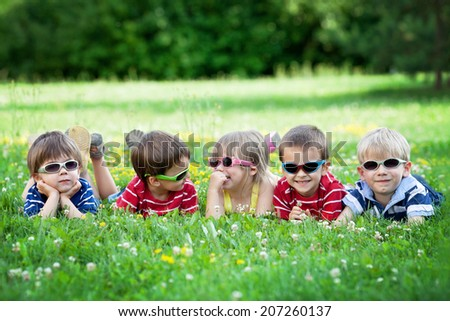 cute young caucasian brother and sister wearing sunglasses with stock photo © feverpitch