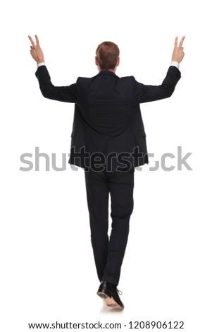 вид сзади бизнесмен победу знак Сток-фото © feedough