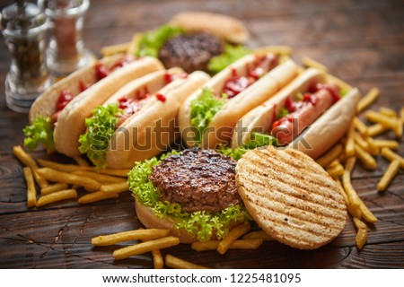 Hot dogs, hamburgers and french fries. Composition of fast food snacks Stock photo © dash