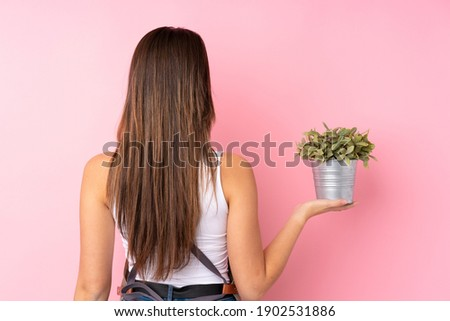 Image of caucasian girl gardener standing over plants in greenho Stock photo © deandrobot