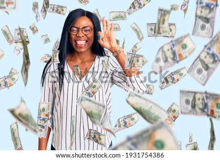 Image of happy afro american woman wearing dollar glasses holdin Stock photo © deandrobot