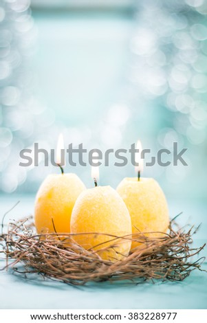 Stockfoto: Quail eggs in the nest on wooden background with willow branch.