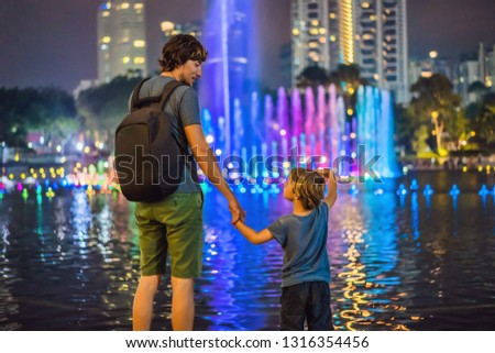 Lake in the evening, near by Twin Towers with city on background. Kuala Lumpur, Malaysia. Morning af stock photo © galitskaya