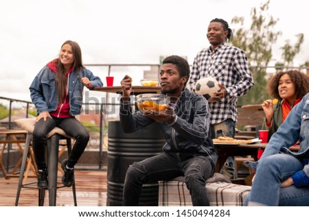 Tense young African man and his friends watching match broadcast Stock photo © pressmaster