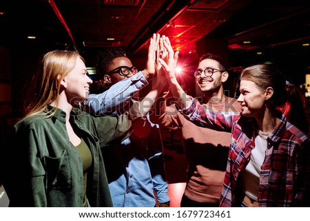 Young ecstatic friends shouting excitedly while cheering during match broadcast Stock photo © pressmaster