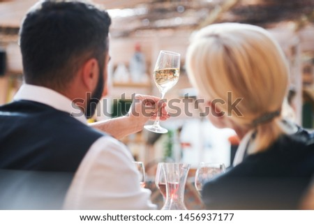 two professional cavists studying characteristics of wine sample in flute stock photo © pressmaster